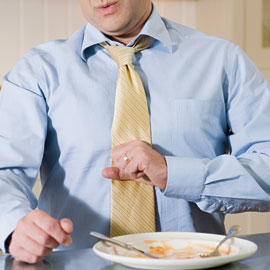 Man with Acid reflux, This occurs when stomach acid backs up into your esophagus.